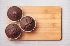 Chocolate muffins on the wood cutting board, text space Stock Image
