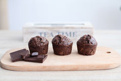 Chocolate muffins on wooden board tea time Royalty Free Stock Photos