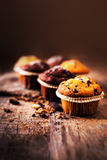 Chocolate muffins on wooden table, homemade bakery, close up ima Royalty Free Stock Images