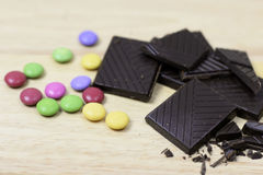 Chocolate with multicolored bonbons. Chocolate with a pile of multicolored bonbons Royalty Free Stock Photos