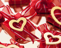 Chocolate na folha vermelha Imagens de Stock Royalty Free
