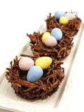 Chocolate nests with Easter eggs Royalty Free Stock Images