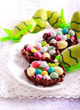 Chocolate nests filled up with egg shaped candies for Easter, Stock Photography