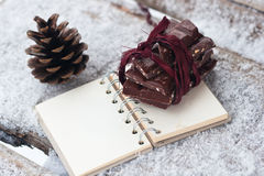 Chocolate on the notebook and strobile Stock Photography
