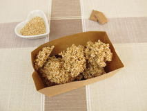 Chocolate nuggets with amaranth in paper bag Royalty Free Stock Image