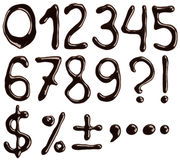 Chocolate numbers. Numbers and symbols written with chocolate syrup Stock Photos