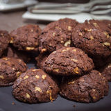 Chocolate and nut cookies on wooden table Royalty Free Stock Photo