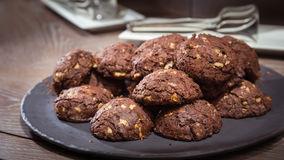 Chocolate and nut cookies on wooden table Royalty Free Stock Images