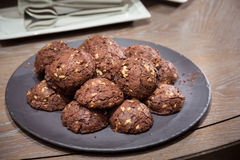 Chocolate and nut cookies on wooden table Royalty Free Stock Photos