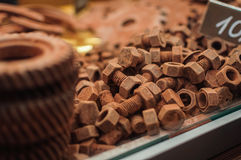 Chocolate nut and screws. Unusual sweets Royalty Free Stock Image