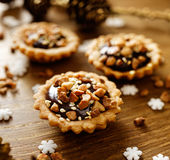 Chocolate nut small tarts. A delicious Christmas dessert Royalty Free Stock Image