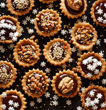 Chocolate nut small tarts. A delicious holiday dessert Royalty Free Stock Image