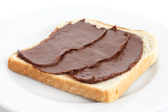 Chocolate nut spread on sliced white bread. Stock Photography