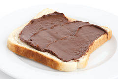 Chocolate nut spread on sliced white bread. Royalty Free Stock Photo