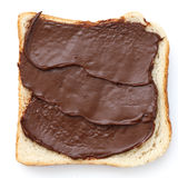 Chocolate nut spread on sliced white bread. Stock Images