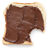 Chocolate nut spread on sliced white bread. Royalty Free Stock Image