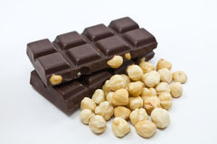Chocolate with nuts. Vector pile of broken chocolate with nuts Royalty Free Stock Photo