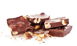 Chocolate with nuts. A pile of chocolate with nuts, on with background Stock Image
