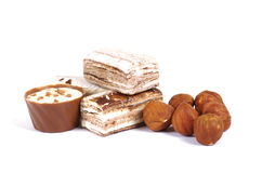 Chocolate and nuts. Over white Royalty Free Stock Photo