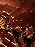 Chocolate and nuts background texture Royalty Free Stock Photos
