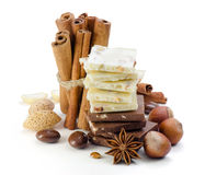 Chocolate, nuts, cinnamon and anise. Spices. royalty free stock image