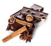 Chocolate and nuts with cinnamon sticks, star anise Royalty Free Stock Photo