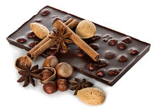 Chocolate and nuts with cinnamon sticks, star anise Stock Images