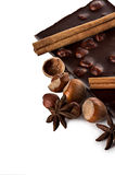 Chocolate and nuts with cinnamon sticks, star anise Stock Photography