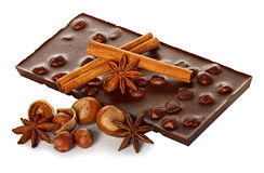 Chocolate and nuts with cinnamon sticks, star anise Royalty Free Stock Images