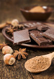 Chocolate, nuts and cocoa powder close up Royalty Free Stock Images