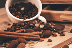 Chocolate with nuts and coffee beans Stock Photos