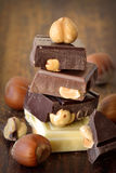 Chocolate with nuts. Dark, milk and white chocolate with nuts Stock Photo
