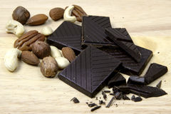 Chocolate and nuts. Dark chocolate with mix of nuts Royalty Free Stock Image