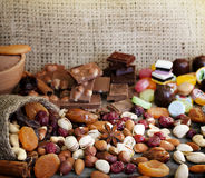 Chocolate nuts dried fruits and candy Stock Photos