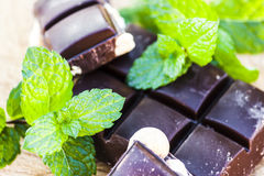 Chocolate with nuts and fresh mint Stock Photos