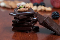 Chocolate, nuts and fruit Stock Images