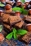 Chocolate, nuts and mint Royalty Free Stock Photography
