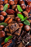 Chocolate, nuts and mint Stock Photos