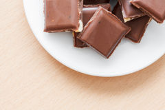 Chocolate with nuts on a plate Stock Photos