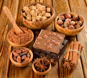 Chocolate, nuts and spices Stock Photos