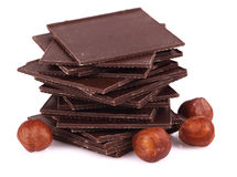 Chocolate with nuts  on white. Stock Photography