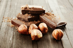 Chocolate with nuts on wooden background Royalty Free Stock Photography