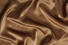 Chocolate o fondo del satén o de la seda del café fotografía de archivo libre de regalías