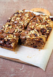 Chocolate and oat cake with nuts Stock Images