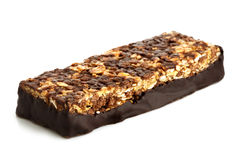 Chocolate, oat and nut bar isolated on white. Royalty Free Stock Photos