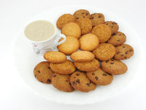 Chocolate and Oats Cookies. Plate with chocolate chip cookies and oat biscuits with coffee Royalty Free Stock Photo