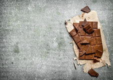 Chocolate on the old fabric. Stock Photography