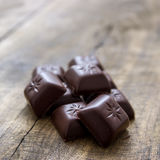 Chocolate on old wooden plank Royalty Free Stock Photo