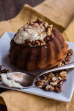 Chocolate orange cake with butter cream and toasted walnuts. Chocolate dessert, restaurant, wooden background Stock Photos