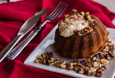 Chocolate orange cake with butter cream and toasted walnuts. Chocolate dessert, restaurant, wooden background stock image